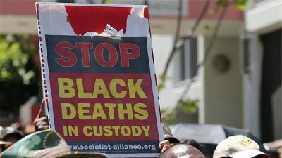 Protesters highlight the fight for justice for Aboriginal deaths in police custody or in prisons [AP]